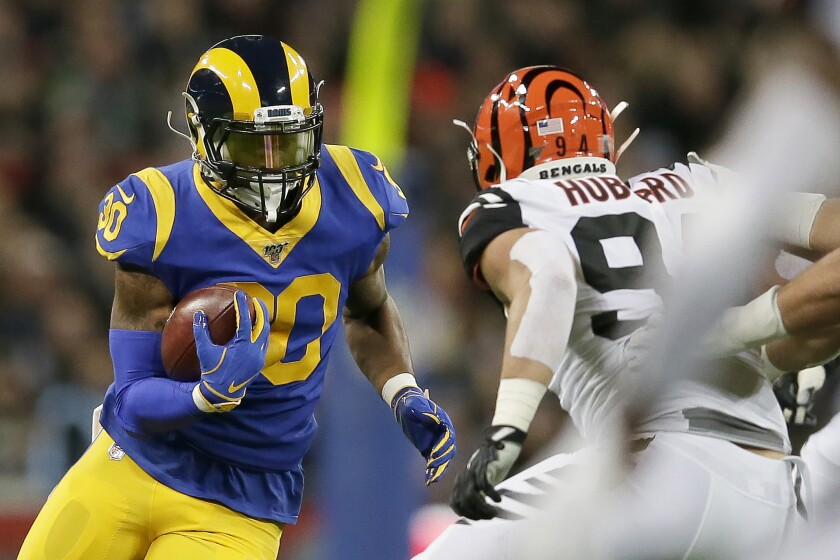 Rams running back Todd Gurley (30) runs against Cincinnati Bengals defensive end Sam Hubbard during the first half on Oct. 27 at Wembley Stadium in London.