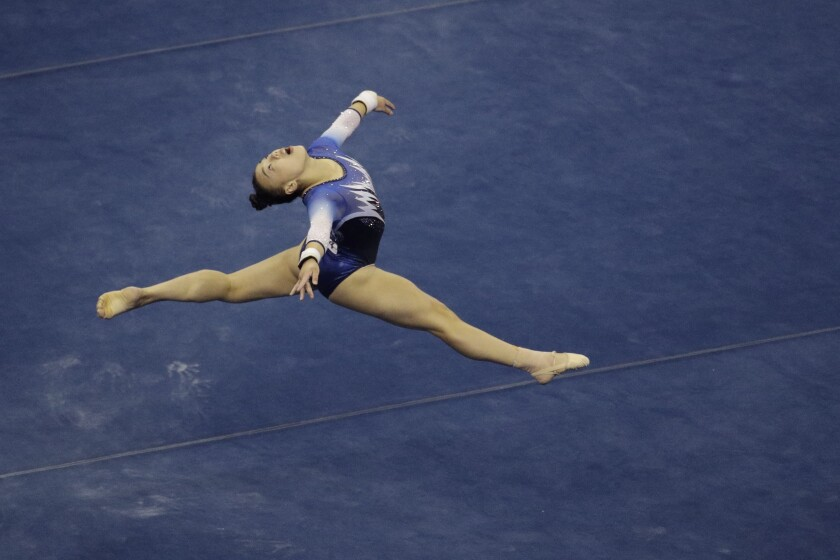 FILE - Emily Lee competes in the floor exercise during the senior women's competition at the 2019 U.S. Gymnastics Championships in Kansas City, Mo., in this Friday, Aug. 9, 2019, file photo. Lee is among the 18 women competing at the 2021 U.S. Olympic Trials in St. Louis starting on Friday night, June 25. (AP Photo/Charlie Riedel, File)