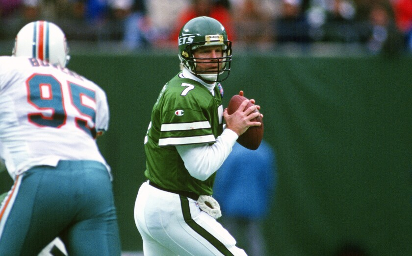 Jets quarterback Boomer Esiason looks to pass against the Dolphins in 1994.