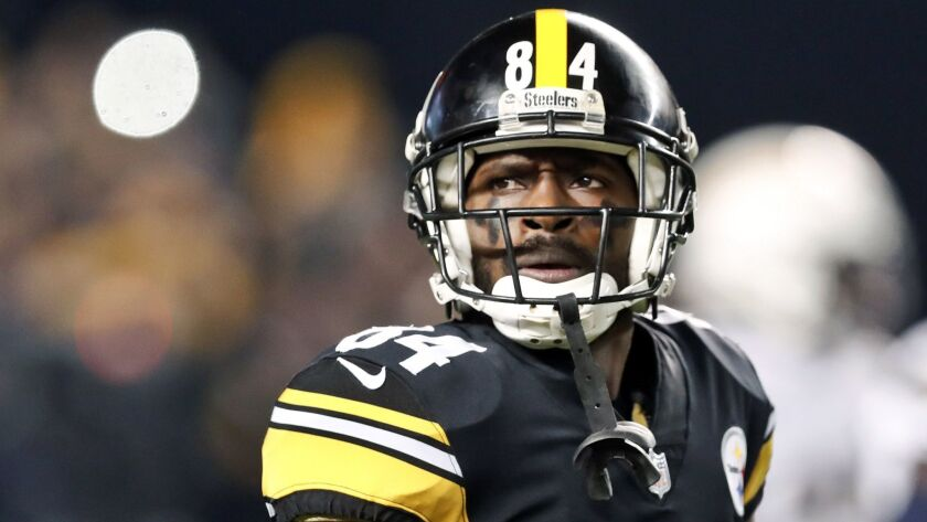 FILE - In this Dec. 2, 2018, file photo, Pittsburgh Steelers wide receiver Antonio Brown (84) plays