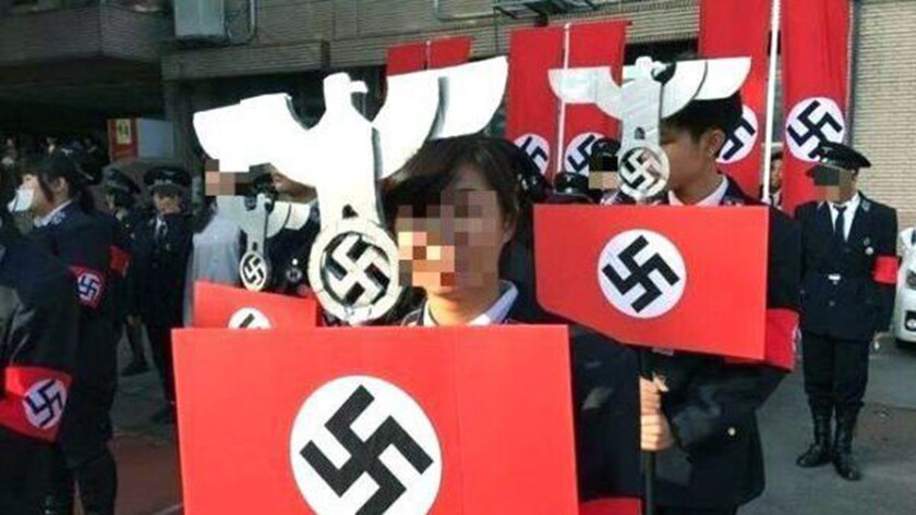 Students' faces are digitally obscured in a photo from the mock rally.