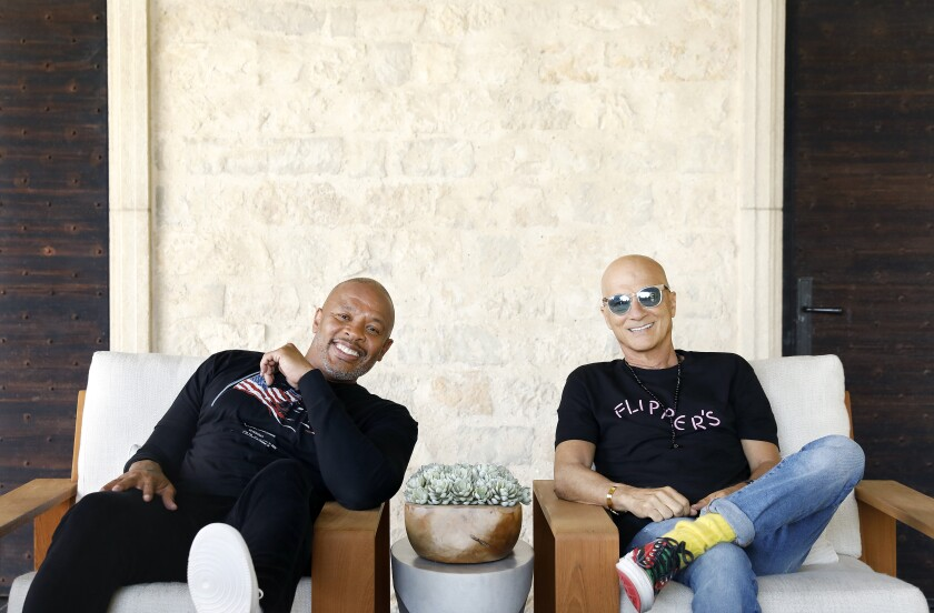 Dr. Dre and Jimmy Iovine, both music moguls from humble roots