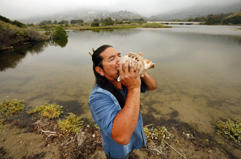 Mati Waiya performs a ceremony in 2010 at the Malibu Lagoon. Is blowing into a conch an actual Chumash practice? Some say no.