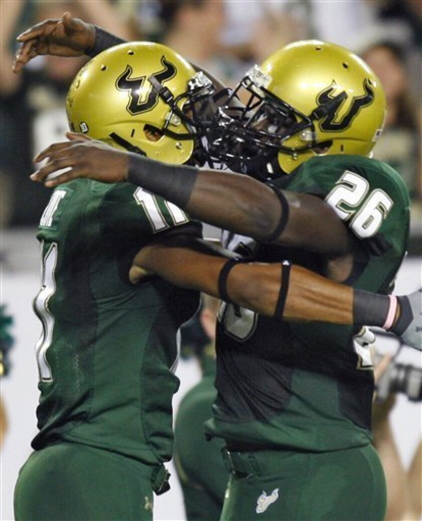 South Florida wide receiver A.J. Love (11) celebrates with teammate Mike Ford (26) after catching a second-quarter touchdown pass during an NCAA college football game against West Virginia Friday, Oct. 30, 2009, in Tampa, Fla. (AP Photo/Chris O'Meara)