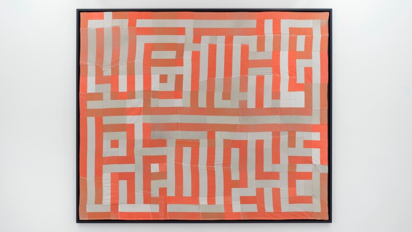 """Hank Willis Thomas' """"We the People,"""" 2015, a quilt made of decommissioned prison uniforms."""