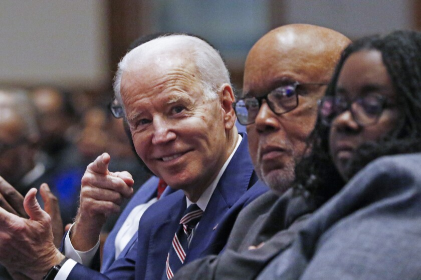 Democratic presidential candidate and former Vice President Joe Biden, left, gestures while seated next to U.S. Rep. Bennie Thompson, D-Miss., prior to speaking at New Hope Baptist Church, Sunday, March 8, 2020, in Jackson, Miss. Seated right, is Thompson's daughter, B.J. Thompson. (AP Photo/Rogelio V. Solis)