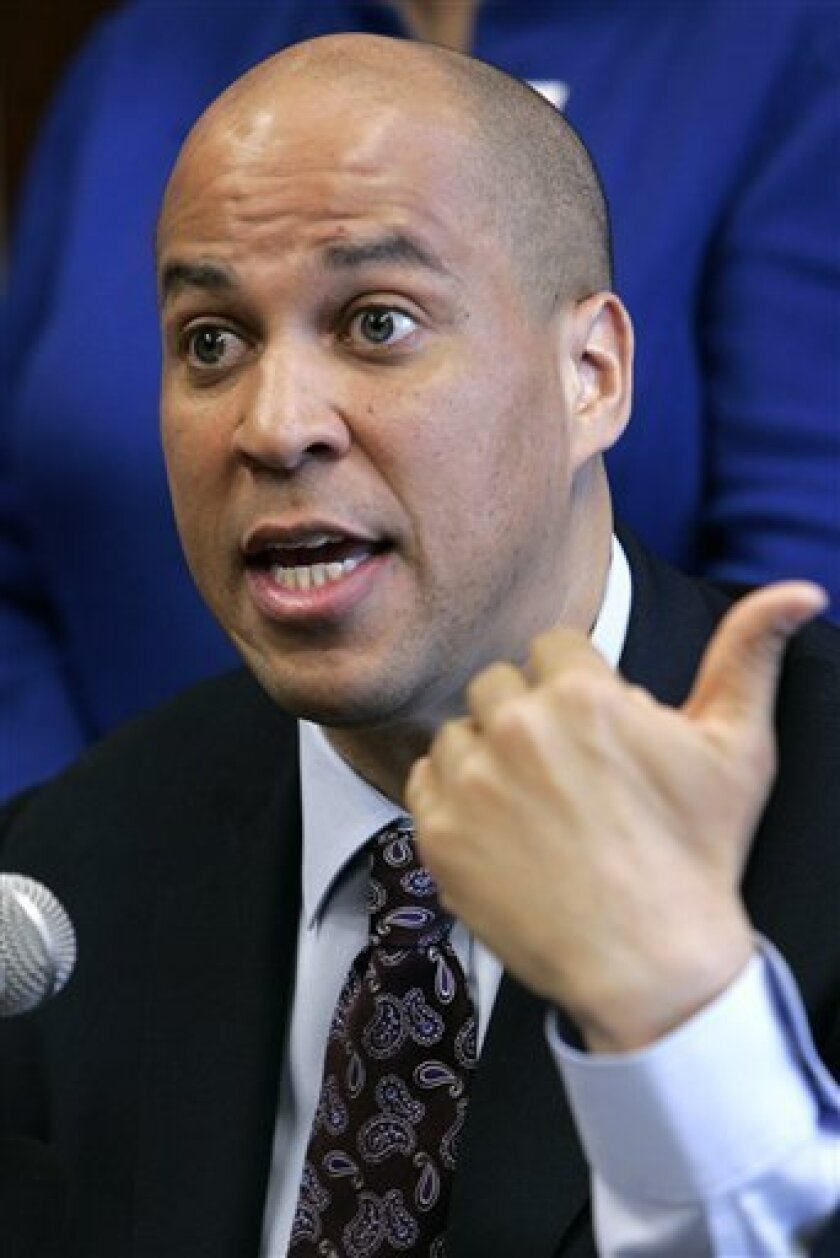FILE - In this March 31, 2009 file photo, Newark, N.J. Mayor Cory Booker gestures during a news conference at city hall in Newark, N.J. Booker and other politicians are blazing a new trail in political discourse as they build huge Internet followings on Twitter's fast-growing social network. (AP Photo/Mike Derer, File)