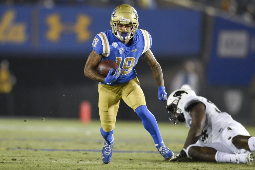 UCLA running back Kazmeir Allen carries the ball Saturday night against Colorado.