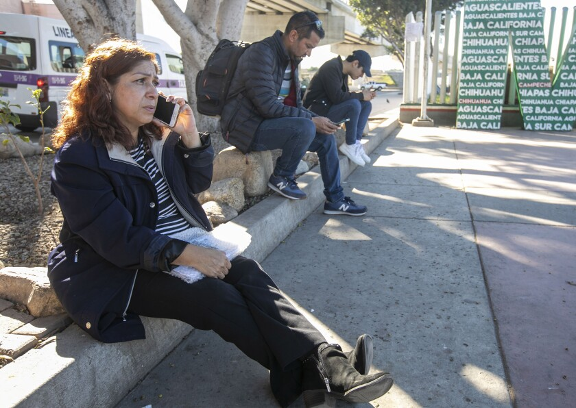 Rocio Rebollar Gomez, whose immigration case has attracted international attention partly because her son is a 2nd lieutenant in the U.S. Army, sat at the curb at the El Chapparal Port of Entry in Mexico after being deported with only her passport, cellphone and the clothes on her back on Jan. 2, 2020.