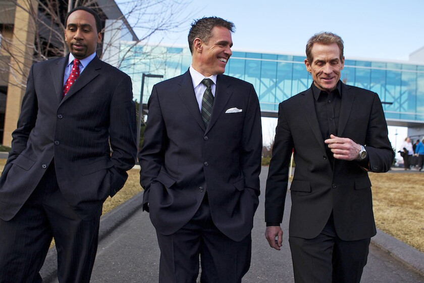"""Analysts on ESPN's """"First Take"""" program are Stephen A. Smith, left, Jay Crawford and Skip Bayless. Smith came under fire for comments made about domestic violence."""