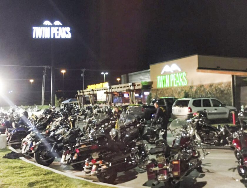 A photo made available by the Waco Police Department via its Facebook page shows motorcycles parked outside the Twin Peaks bar and restaurant.