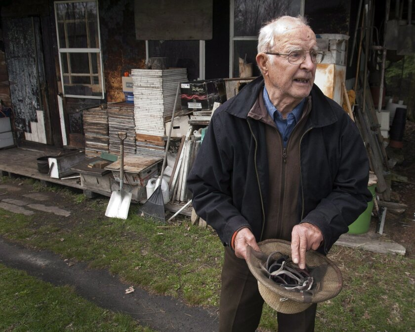 FILE - In this April 25, 2012 file photo, Vladimir Katriuk stands at his honeybee farm in Ormstown, Quebec. The second most wanted man on the Simon Wiesenthal Center's list of Nazi war criminals — charged earlier this month by Russia with genocide — has died at age 93, his lawyer said. Katriuk pass