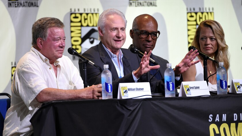 "William Shatner, from left, Brent Spiner, Michael Dorn and Jeri Ryan attend the ""Star Trek"" panel on day 3 of Comic-Con International on July 23 in San Diego."