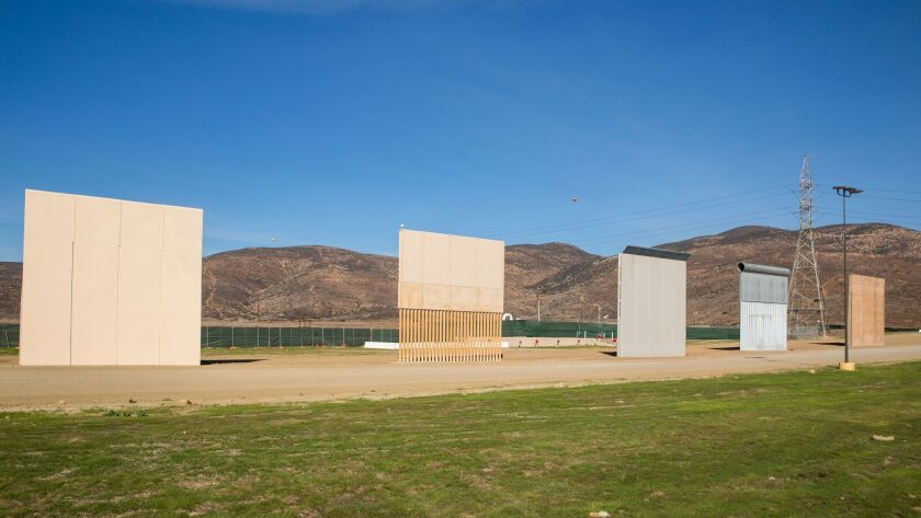 TIJUANA, CA - FEBRUARY 01: A tour group hosted by MAGA/Hauser & Wirth views the Border Wall prototyp