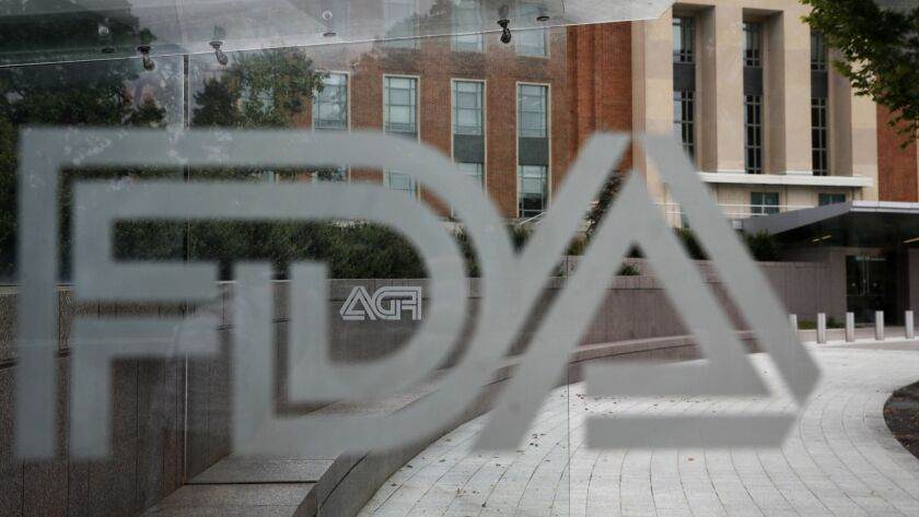 FILE - This Aug. 2, 2018 file photo shows the U.S. Food and Drug Administration building behind FDA