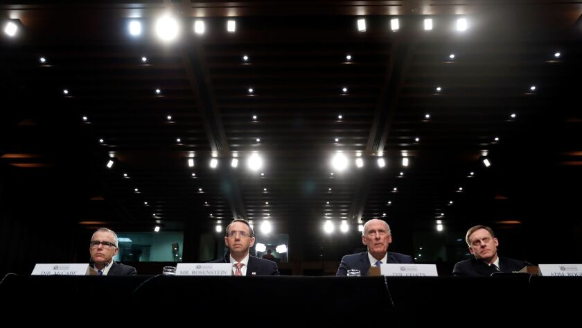 FBI acting director Andrew McCabe, Deputy Attorney General Rod Rosenstein, Director of National Intelligence Dan Coats, and National Security Agency director Adm. Mike Rogers are seated during a hearing about the Foreign Intelligence Surveillance Act in Washington, on June 7.