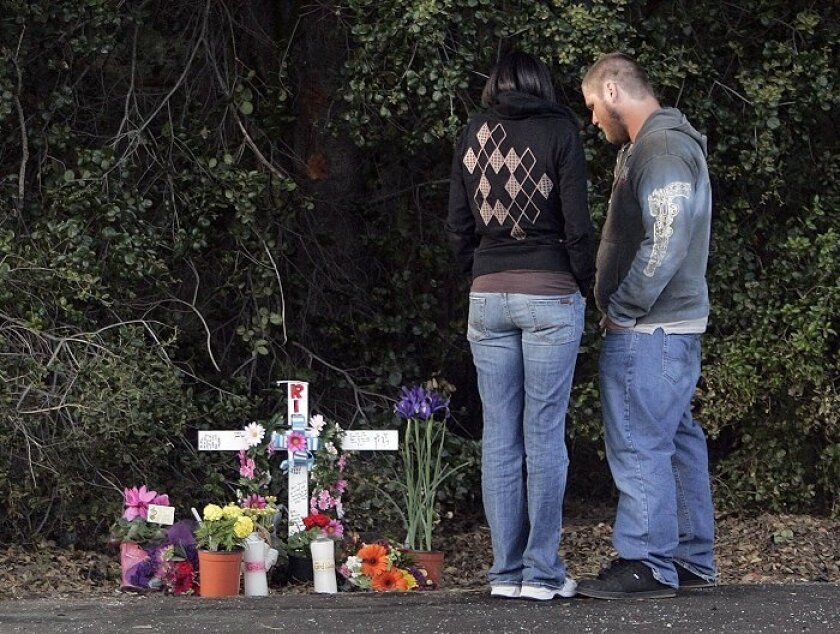 Alexandria Drake's brother Shannon Paul McKeirnan and his girlfriend, Zakiyyah Rhones, visited a roadside memorial for Drake yesterday.