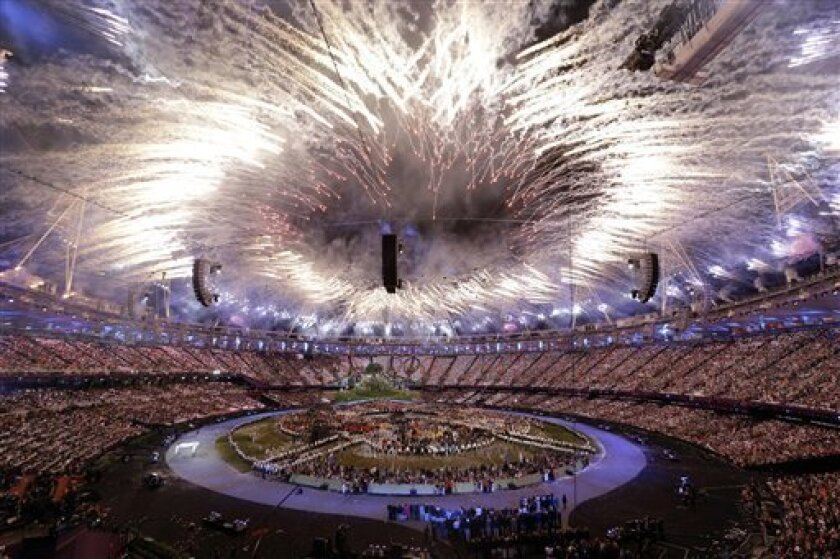 "In this Friday, July 27, 2012 photo fireworks explode during the Opening Ceremony at the 2012 Summer Olympics, in London. The International Olympic Committee expects that almost 900 million people watched part of the London Games opening ceremony on television. The IOC's television and marketing director Timo Lumme says it is the target figure for ""global viewership ... that's all eyeballs across the world."" The final, official rating will be lower than 900 million. It counts in-home viewers watching for longer periods and will be announced within months. Lumme says around 80 of 200 national television markets have audited figures. Others are estimated. (AP Photo/Paul Sancya)"
