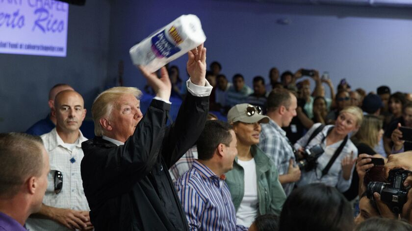 President Trump tosses paper towels into a crowd of Puerto Ricans during a visit to the storm-ravaged island of more than 3 million Americans on Oct. 3, two weeks after it was hit by Hurricane Maria on the heels of Hurricane Irma.