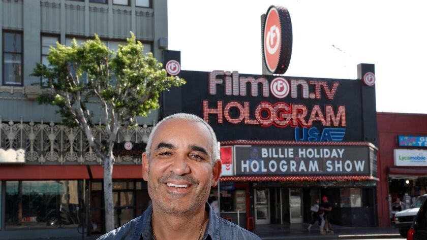 Billionaire Alki David and a view of the exterior of Hologram USA Theater on Hollywood Boulevard. David has been trying to get this theater off the ground for more than a year.
