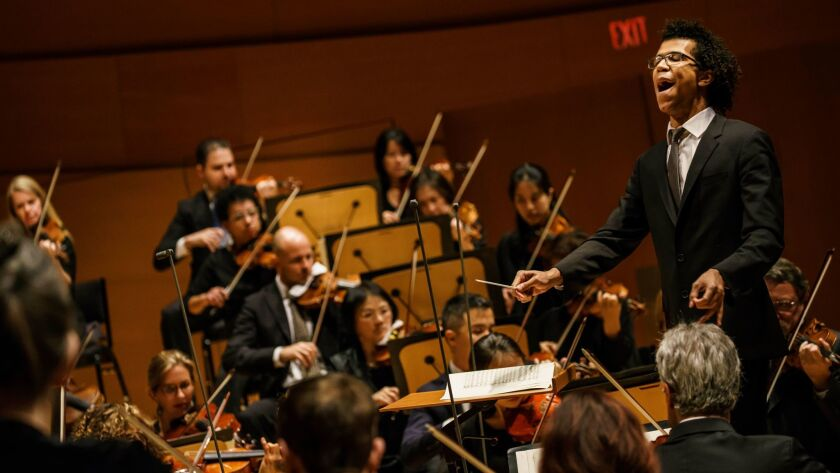 LOS ANGELES, CALIF. -- SUNDAY, DECEMBER 3, 2017: Conductor Jonathon Heyward leads the LA Philharmoni