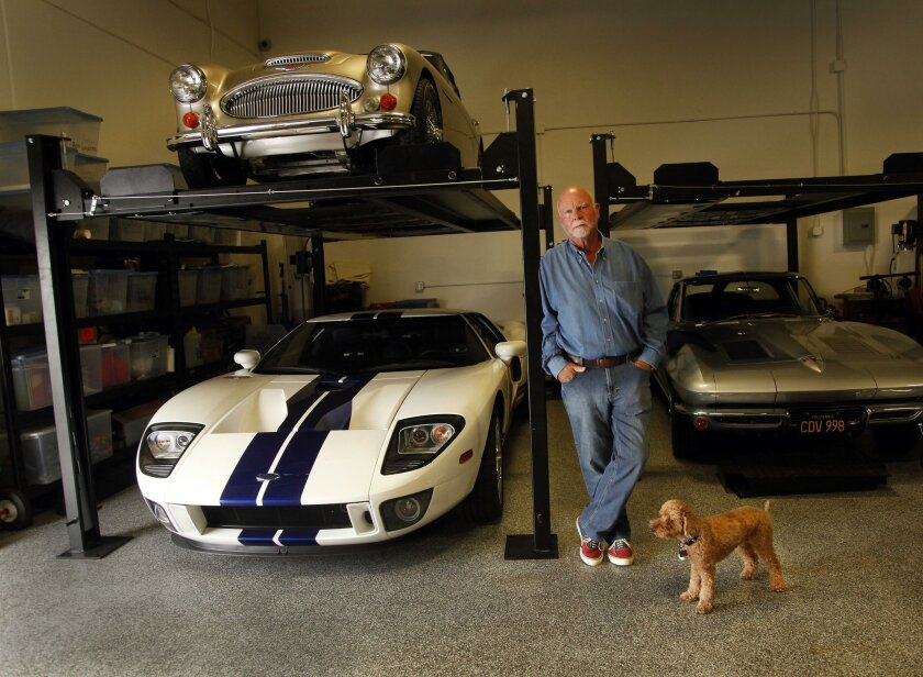 J. Craig Venter with his dog, Darwin, and part of his collection of vehicles. / photo by John Gastaldo * U-T