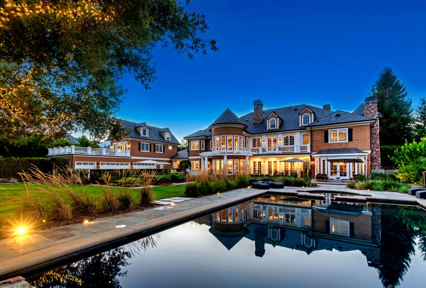 The custom Cape Cod enjoys mountain, lake and golf course views from its 1.2-acre lot. Found in guard-gated Lake Sherwood, the Hamptons-inspired home spans 10,700 square feet with five bedrooms, eight bathrooms and a handful of dramatic living spaces.