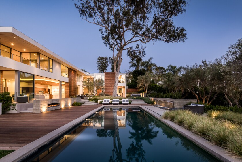 Board-form concrete, expanses of glass and modular shapes form the clean, contemporary shell of this newly built estate in Pacific Palisades. Listed for $26.75 million, the three-story house features nearly 14,000 square feet of living space, eight bedrooms and 12 bathrooms.