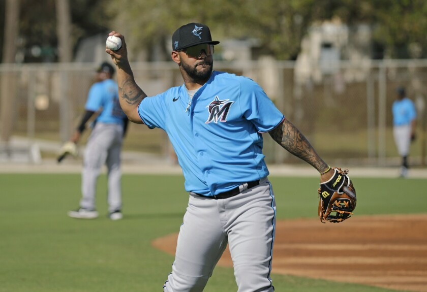 Miami Marlins infielder Jonathan Villar (2) run drills during the spring training workout at Roger Dean Stadium on Thursday, February 20, 2020 in Jupiter, Fla.