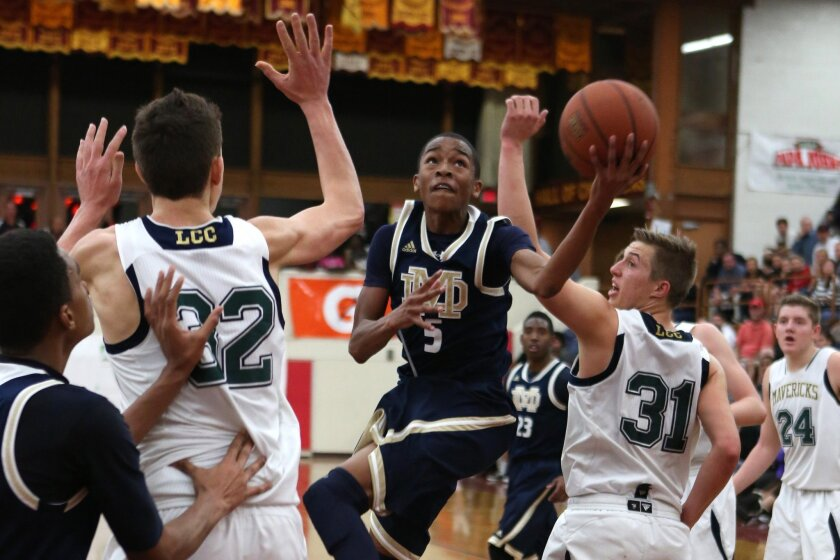 Mater Dei Catholic freshman Jaylen Hands (5) looks for an opening against La Costa Canyon's defense. Hands, who scored 20 points, earned all-tournament honors in helping the Crusaders to the American Division title.