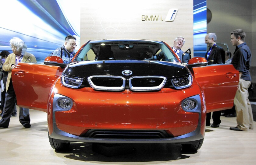 The BMW i3, a five-door, zero-emissions electric car, is displayed at the 2013 Los Angeles Auto Show at the Convention Center in downtown L.A.