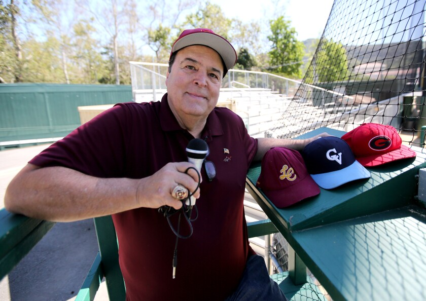 Area sports announcer Spiro Psaltis poses with a microphone at an empty Stengel Field in Glendale.