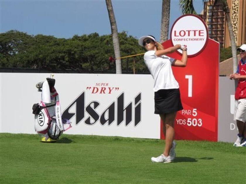 LPGA golfer Michelle Wie hits a drive on hole No. 1 during a Pro-Am played the day before the LPGA Lotte Championship in Kapolei, Hawaii on Tuesday, April 16, 2013. (AP Photo/Oskar Garcia)