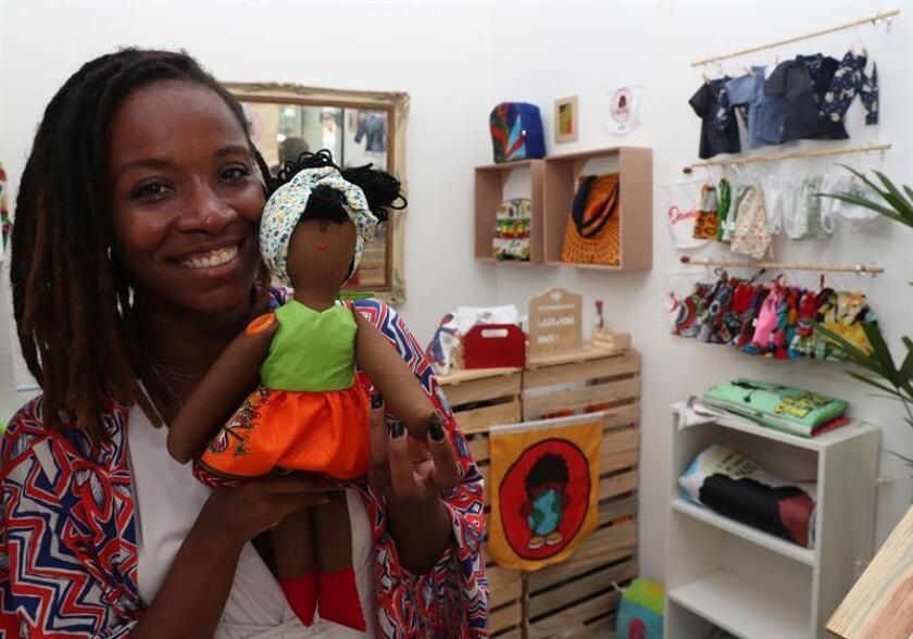 "Jaciana Melquiades owner of the doll store ""Era uma vez o mundo"" posing next to the doll ""Dandara"" in the first black doll shop in Brazil on Feb 19, 2019 in Rio de Janeiro Brazil. EPA-EFE/ Marcelo Sayão"