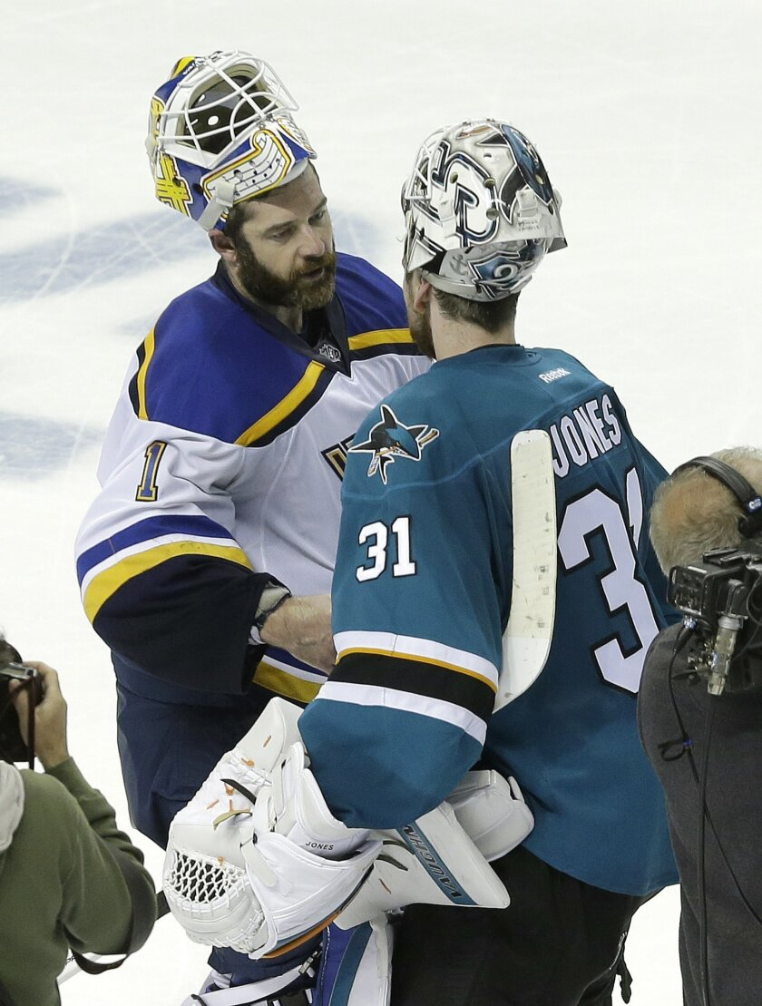 St. Louis Blues goalie Brian Elliott, left, greets San Jose Sharks goalie Martin Jones (31) after the Sharks beat the Blues in Game 6 of the NHL hockey Stanley Cup Western Conference finals in San Jose, Calif., Wednesday, May 25, 2016. The Sharks won 5-2. (AP Photo/Jeff Chiu)