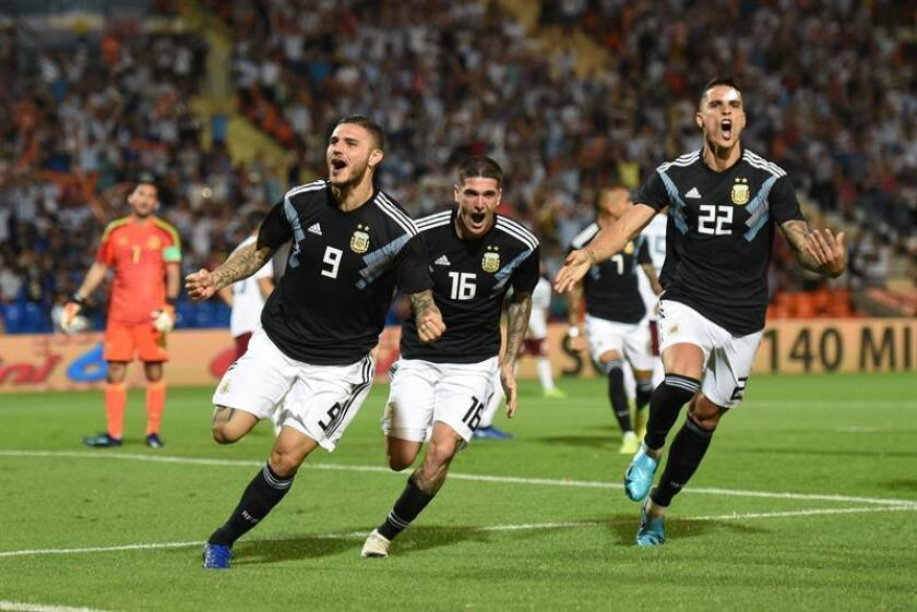 Argentina's Mauro Icardi (R) celebrates after scoring with Rodrigo De Paul (C) and Eric Lamela (L) during a friendly match between Argentina and Mexico at the Malvinas Argentinas stadium, in Mendoza, Argentina, 20 November 2018. EPA-EFE/Pachy Reynoso