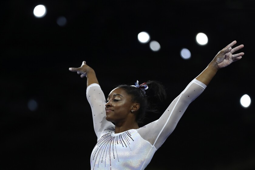 Simone Biles of the United States performs on the vault in the women's all-around final at the Gymnastics World Championships in Stuttgart, Germany, Thursday, Oct. 10, 2019. (AP Photo/Matthias Schrader)