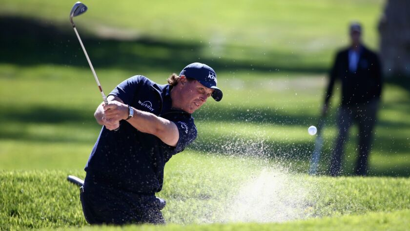Phil Mickelson plays a shot from a bunker on the seventh hole during the second round of the Farmers Insurance Open at Torrey Pines South on January 26, 2018 in San Diego, California.