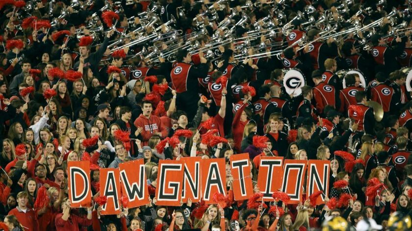 Georgia students and band in the stands in Athens, Ga., at last year's game against Missouri. The first-regular season meeting between Georgia and Notre Dame in South Bend, Ind., on Saturday is the most-anticipated road trip the Bulldogs have made in decades.