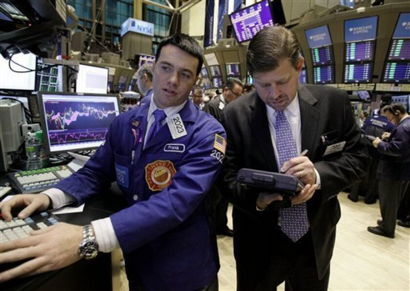 Specialist Frank Masiello, left, directs trades at his post on the floor of the New York Stock Exchange, Monday, Nov. 1, 2010. (AP Photo/Richard Drew)