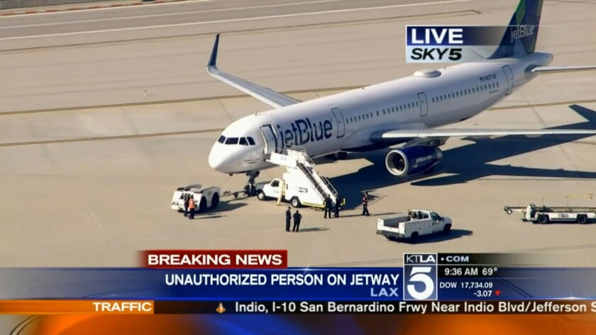 Police search a JetBlue flight bound for New York on Thursday.
