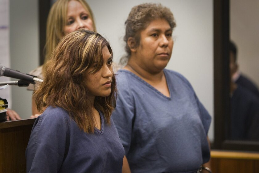 Carla Cornelio, left, and her mother, Alba Cornelio, at their 2011 arraignment in San Diego Superior Court after their two pit bulls attacked and mauled their neighbor, Emako Mendoza, 75, on June 18, 2011.