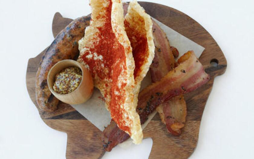 The hog bar pork sampler at Kensington Grill