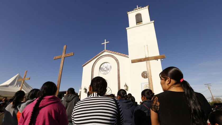 Family and friends attend funeral services on April 2 at Our Lady of Guadalupe Church in Delano for migrant farmworkers, whose vehicle crashed as they fled immigration agents.