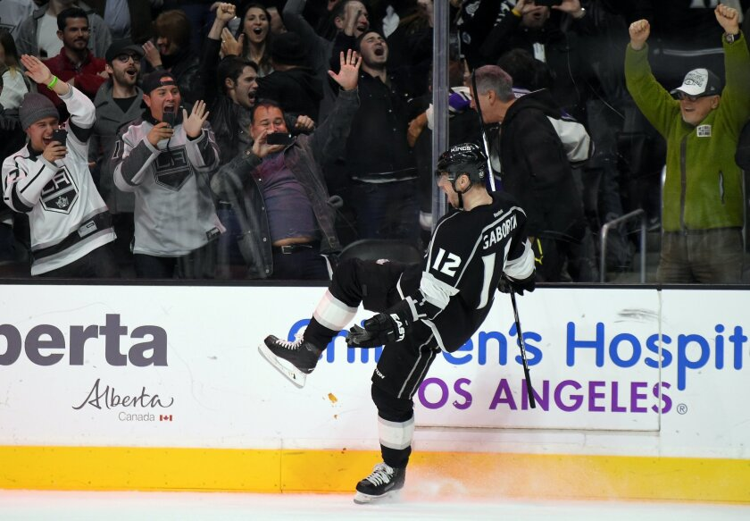 Los Angeles Kings right wing Marian Gaborik, of Slovakia, celebrates after scoring the game-winning overtime goal against the Chicago Blackhawks in an NHL hockey game, Saturday, Nov. 28, 2015, in Los Angeles. The Kings won 3-2. (AP Photo/Mark J. Terrill)