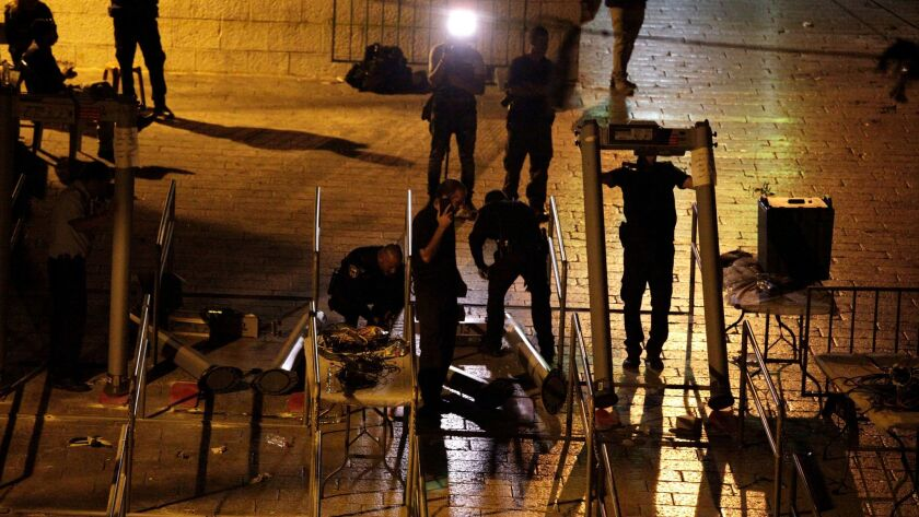 Israeli police dismantle metal detectors outside Al Aqsa Mosque compound in Jerusalem's Old City on July 25, 2017.