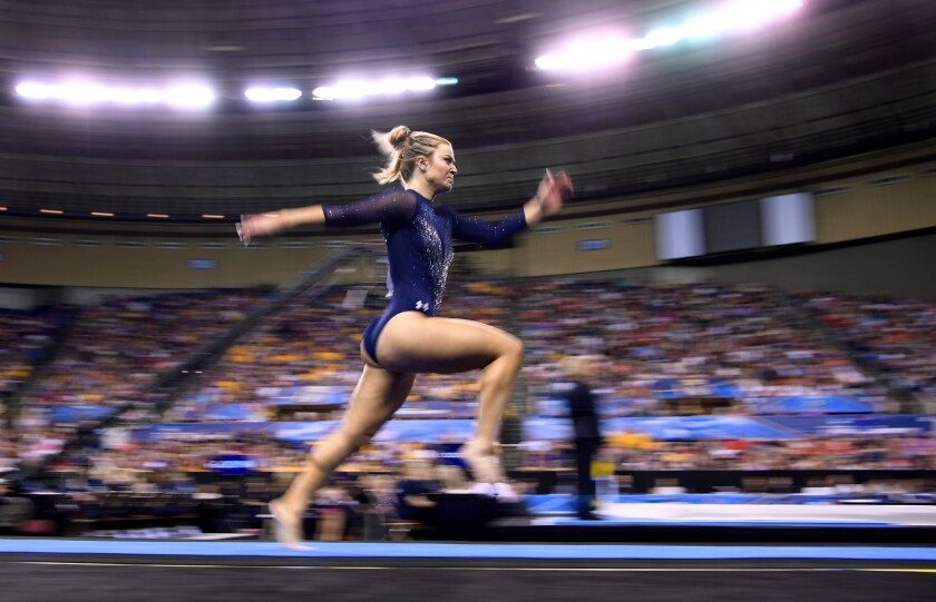 UCLA's Gracie Kramer competes in the vault at the NCAA championships in Fort Worth in April 2019.