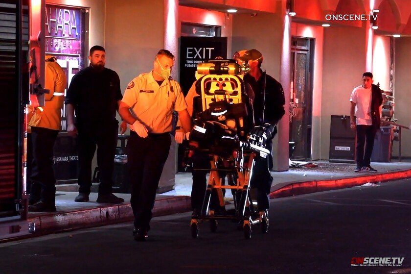 An injured person is wheeled to an ambulance after a shooting at the Sahara Theater club in Anaheim.