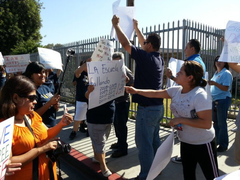 A rally to support Irma Cobian, principal of Weigand Avenue Elementary School, who was recently ousted under the parent trigger law, provoked confrontation between her supporters and opponents.
