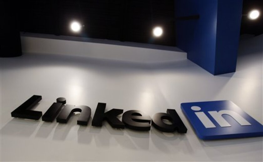 FILE - In this May 19, 2011 file photo,the LinkedIn logo is displayed in the foyer at headquarters in Mountain View, Calif. LinkedIn Corp., releases quarterly financial results Thursday, Feb. 9, 2012, after the market close. (AP Photo/Paul Sakuma, File)